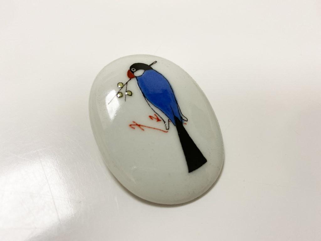 クタニシールの文鳥のブローチ